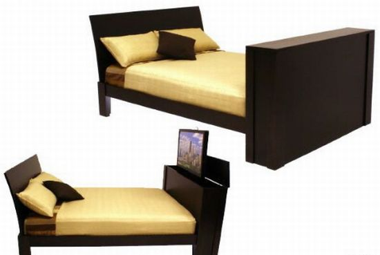 bed with tv in footboard