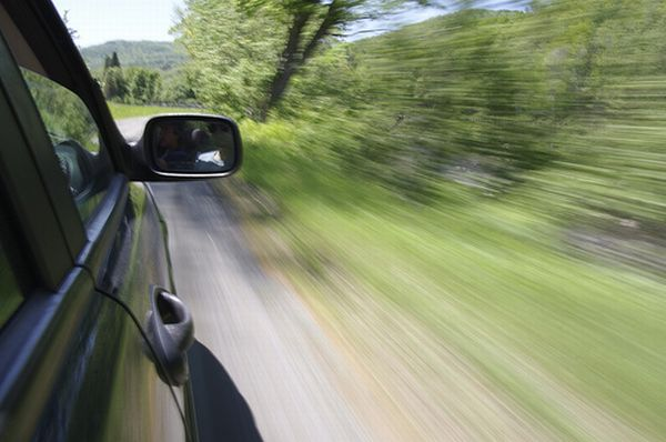 If in a moving vehicle, stop as quickly as safety permits