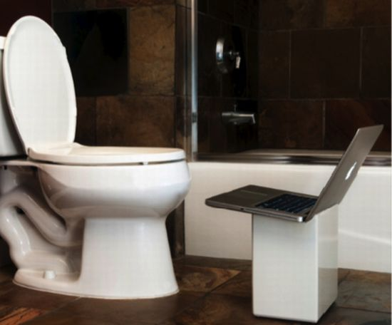 ipoop bathroom wastebasket doubles as a laptop stand