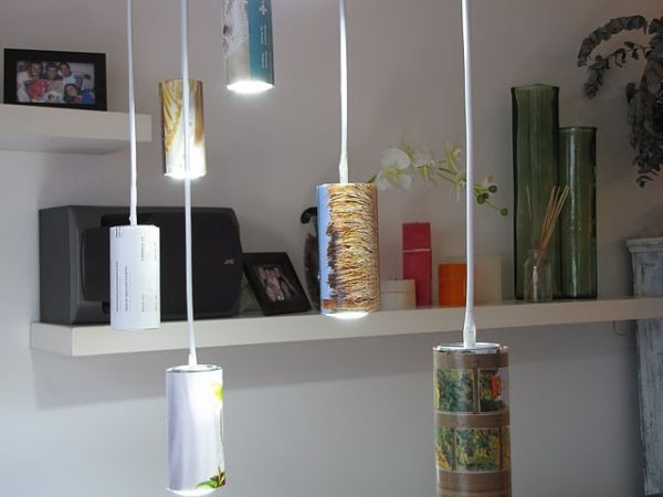 Light made of beer cans and old magazine