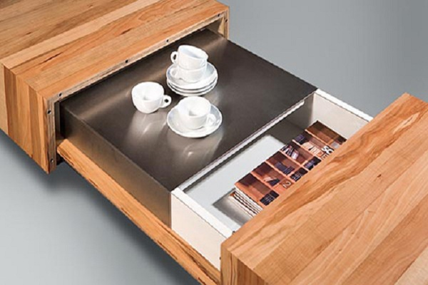 Wooden coffee table with sliding lids