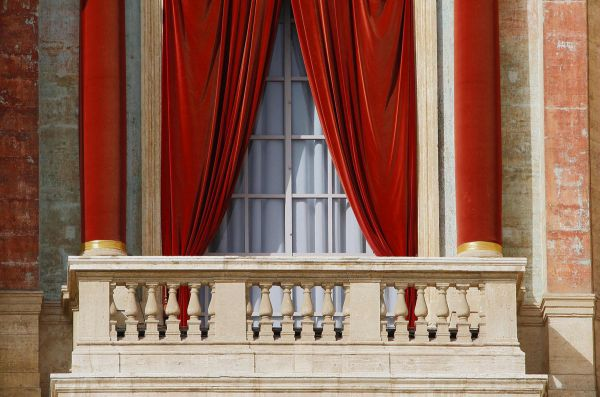 The red curtains on the central balcony of Saint Peter's Basilica, called the Loggia of the Blessings, are seen at the Vatican