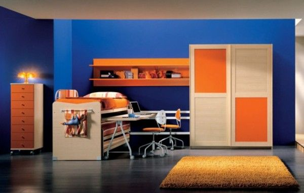 dark-blue-wall-paint-and-dark-orange-interior-for-teen-bedroom