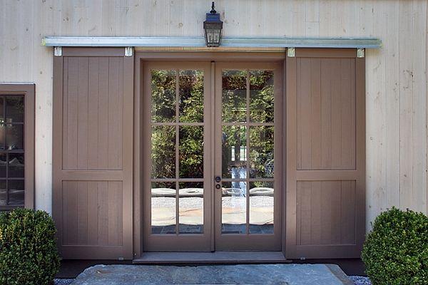 barn style sliding doors outside the glass doors