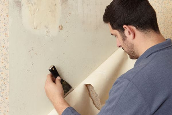 removing wallpapers from walls by stripping