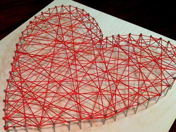 Criss-crossed heartstring yarn art