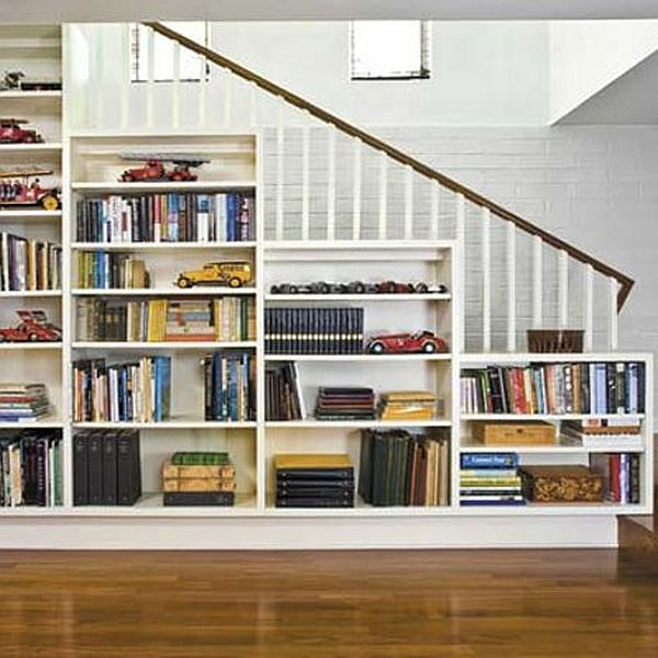 book shelve on the wall running along the staircase