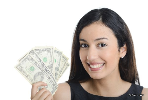 isolated portrait of beautiful and successful young business woman holding us dollar bills
