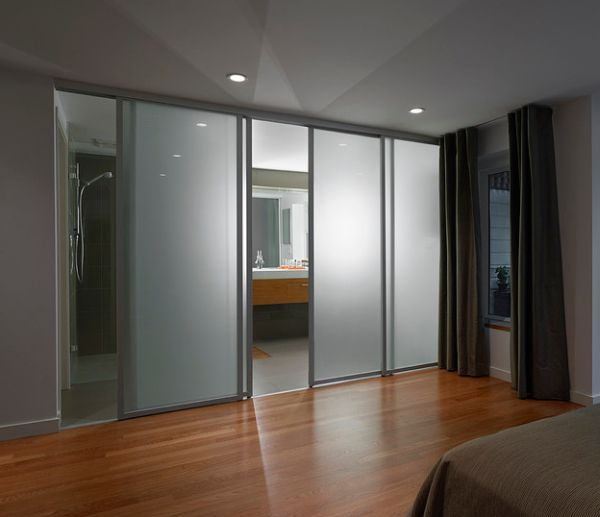 glass partition separate two adjacent rooms
