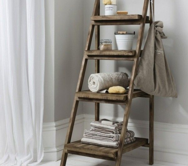 wooden ladder turned into a towel rack