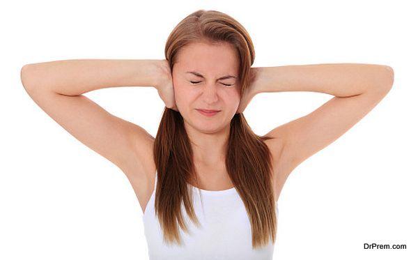 Girl keeps her ears shut