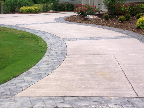 Refinished concrete driveway with custom inlay stamping