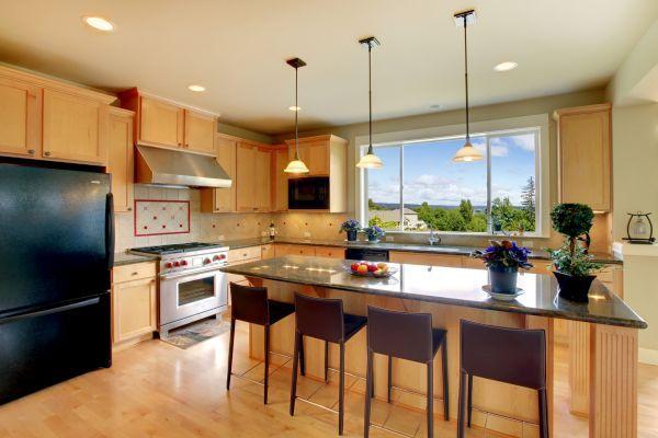 Beautiful classic wood kitchen with hardwood floor.