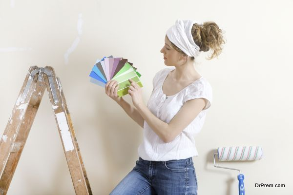 a young woman wants to paint her home looking for a suitable color