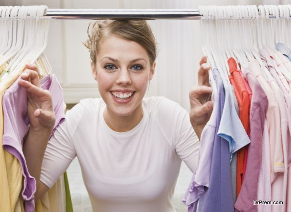 Woman looking through closet