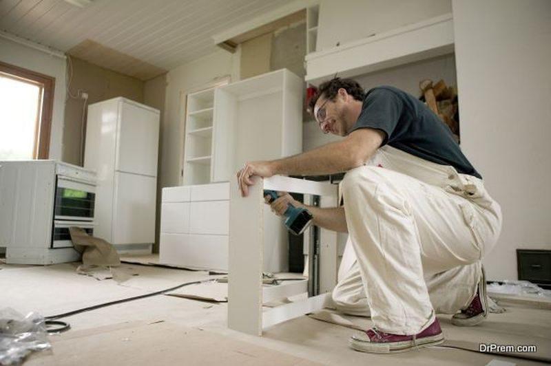 Assembling kitchen units.