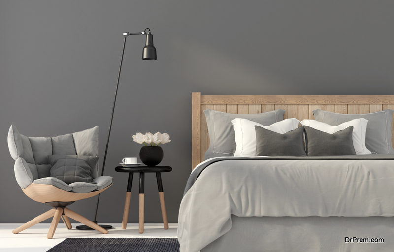 Gray bedroom with a wooden bed
