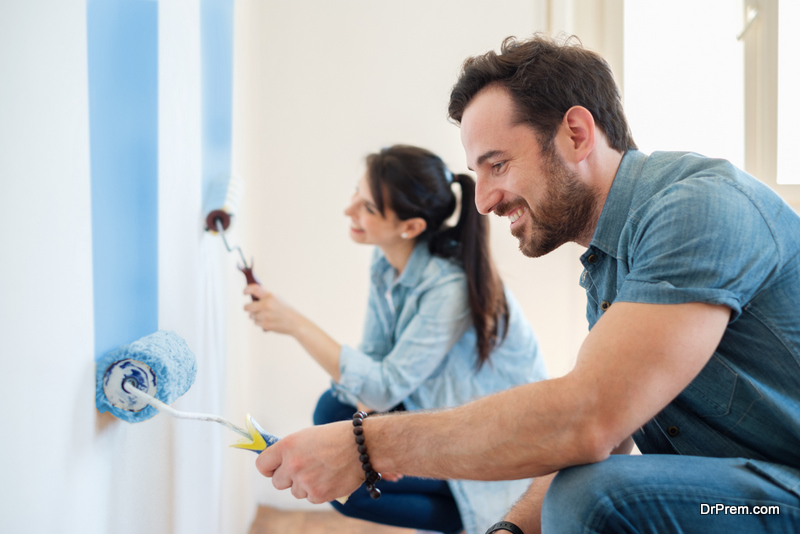 couple-busy-in-doing-a-coat-of-paint