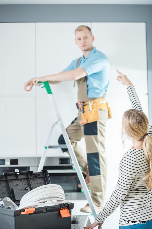 woman-instructing-electrician