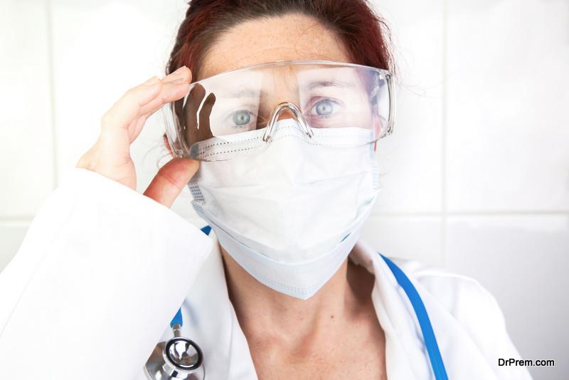 doctor adjusting her protective glasses
