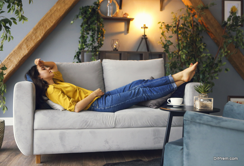 Young brunette woman relaxing on the couch
