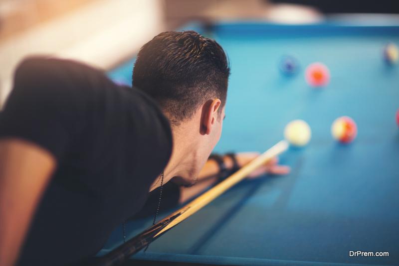 man-enjoying-billiards