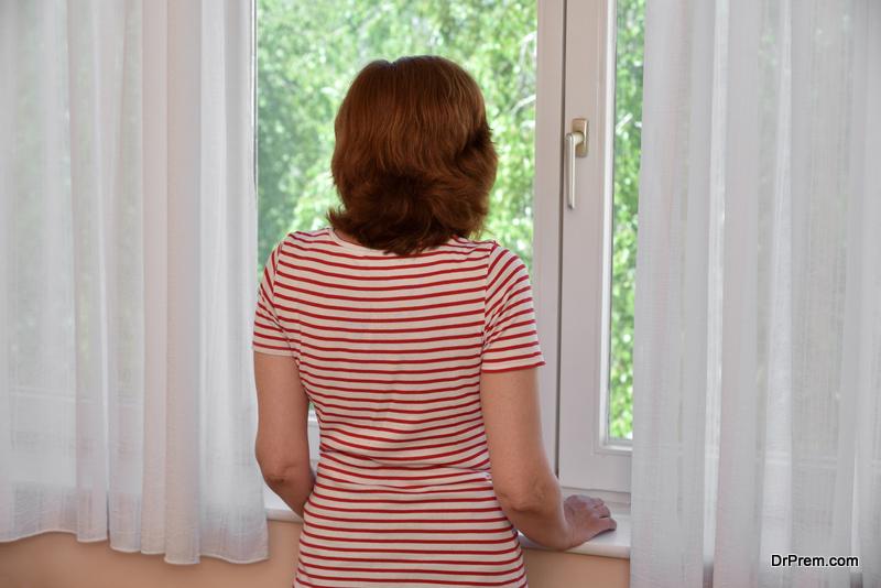 woman-closing-window