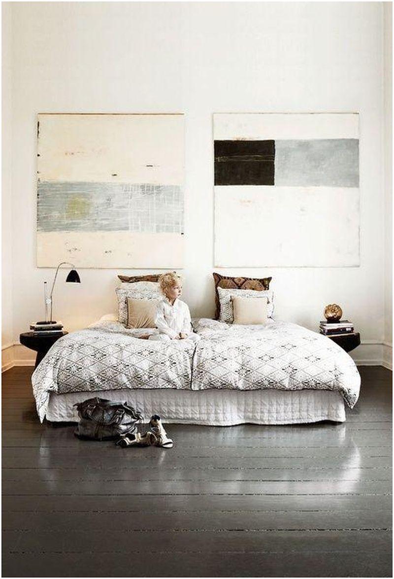 Oversized art inside a grey bedroom